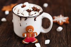 Mug of hot chocolate or cocoa with Christmas cookies and marsmal. Low on dark wooden background Stock Image