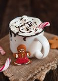 Mug of hot chocolate or cocoa with Christmas cookies and marsmal. Low on dark wooden background Royalty Free Stock Images