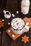 Mug of hot chocolate or cocoa with Christmas cookies and marsmal. Low on dark wooden background Stock Photography