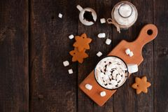 Mug of hot chocolate or cocoa with Christmas cookies and marsmal. Low on dark wooden background Royalty Free Stock Photo