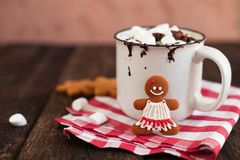 Mug of hot chocolate or cocoa with Christmas cookies and marsmal. Low on dark wooden background Royalty Free Stock Photos