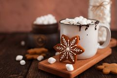 Mug of hot chocolate or cocoa with Christmas cookies and marsmal. Low on dark wooden background Stock Photos