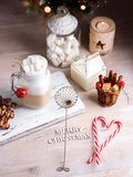 Mug with hot chocolate drink and marshmallows on the top. Christmas colorful still life. Cozy festive mood. royalty free stock photos
