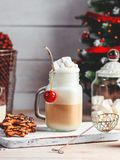 Mug with hot chocolate drink and marshmallows on the top. Christmas colorful still life. Cozy festive mood. stock photo