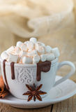 Mug with hot chocolate, marshmallows and cinnamon on wooden table. Rustic style Stock Photos