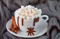 Mug with hot chocolate, marshmallows and cinnamon on wooden table. Rustic style Royalty Free Stock Photos
