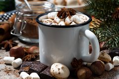 Mug of hot chocolate with marshmallows and sweets. On wooden table, closeup horizontal stock image