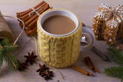 Mug of hot cocoa, good image to convey a feeling of winter and warmth. Winter drink - hot chocolate with cinnamon and anise on woo. Den background. Coffee with royalty free stock photo