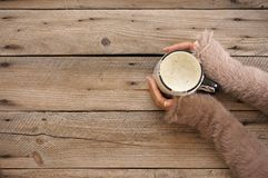 Mug of hot coffee in woman hands stock photography