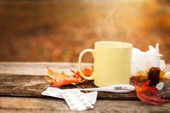 Mug with hot tea and thermometer showing high temperature along Stock Photography