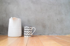 Mug and jar on wood floor Royalty Free Stock Photos