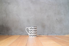 Mug and jar on wood floor Royalty Free Stock Photo