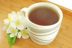 Mug of jasmine tea Royalty Free Stock Images