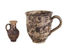MUG AND JUG. Jug and mug made of clay. cookware. souvenir royalty free stock images