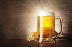 Mug of lager beer with a solar flare Royalty Free Stock Image