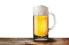 Mug of lager beer on wooden rack Stock Images