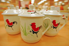 Mug and Lid with Red Rooster painted Royalty Free Stock Photos