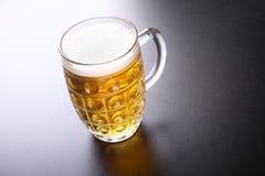 Mug of light beer Stock Images