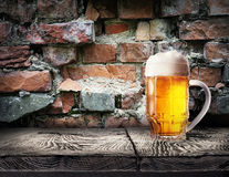 Mug of light beer foam Royalty Free Stock Image