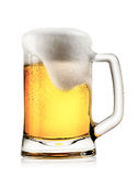 Mug of light beer with foam Stock Images