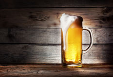 Mug of light beer with foam Royalty Free Stock Images