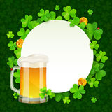 Mug of light beer on green clovers round Stock Image