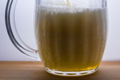 mug with light beer pour Royalty Free Stock Photo