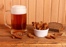 Mug with light beer and salty crackers Royalty Free Stock Image