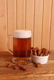 Mug with light beer and salty crackers Stock Images