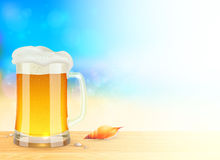 Mug of light beer on summer sea blurred background Stock Photo