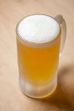 Mug of light beer on wood Royalty Free Stock Photography