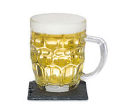 Mug of light shandy beer on slate mat isolated Royalty Free Stock Photography