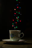 A mug of love. White mug standing on the table, love hearts bokeh stock images