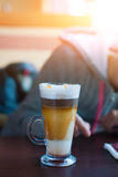 Mug with makiato. Transparent mug with coffee machiato is on the table Royalty Free Stock Photography
