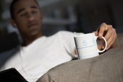 Mug of a man in his living room Royalty Free Stock Image