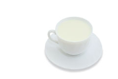 Mug with milk. Mug with the milk, standing on a saucer on a white background. With clipping path Royalty Free Stock Photo