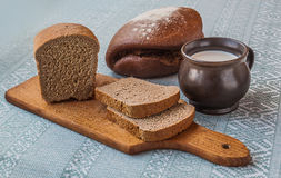 Mug of milk and  bread Royalty Free Stock Images