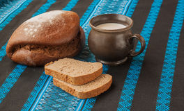 Mug of milk and  bread Stock Photography