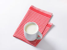 Mug of milk Stock Images