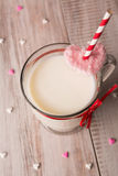 Mug of milk and hearts for Valentines Day Royalty Free Stock Photos