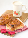 Mug of milk and rolls Stock Images