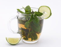 Mug with mint tea and lime Royalty Free Stock Photo