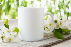 Mug mockup with apple blossom. Mug mockup. Coffee cup template. Coffee mug template. Mug template. Mug design template. Mug design. Mug printing design. White stock photo