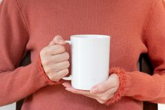 Mug Mockup. Women`s Hands Holding Mug With Blank Space For Your Text Or Promotional Content Stock Image