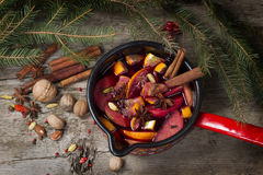Mug with mulled wine on wooden table Stock Photos