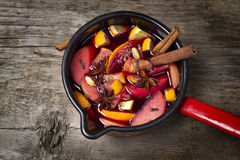 Mug with mulled wine on wooden table Stock Image
