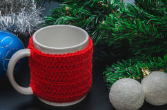 Mug and New Years toys Stock Photos
