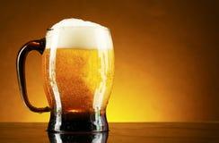 Free Mug Of Beer On A Yellow Stock Photography - 20130272
