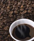 Mug Of Coffee And Grain Stock Photo