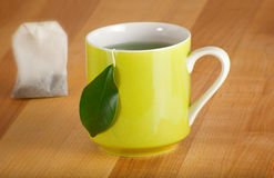 Mug of Organic Green Tea and Teabag Stock Photos